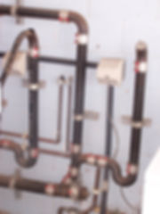 Industrial water pipe installation with many worm gear clamps and Clamp-aid  covers