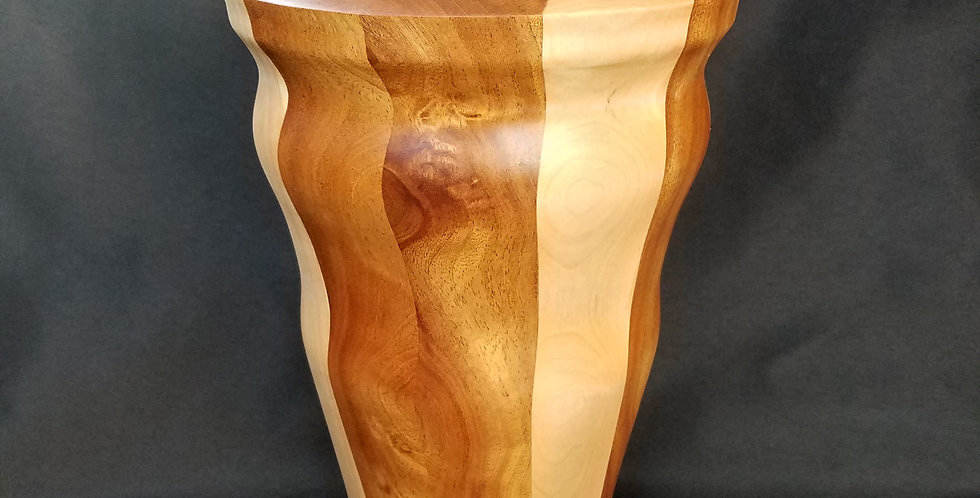 Wood vase elegantly turned intricate grains African mahogany and eastern maple.