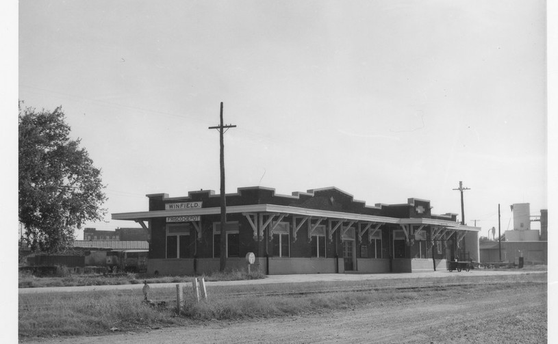 St. Louis-San Francisco Railway depot, Winfield, Kansas This black and white photograph shows the St. Louis-San Francisco Railway Company depot at Winfield, Kansas. It was in the Western Division, Beaumont sub division, at milepost 500.4. Creator: Killam, H.  Date: September 21, 1965