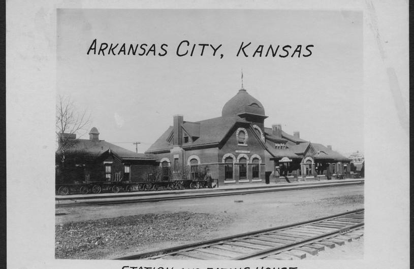 Atchison, Topeka and Santa Fe Railway Company depot, Arkansas City, Kansas  This photograph shows the Atchison, Topeka and Santa Fe Railway Company depot and eating house in Arkansas City, Kansas.  Creator: Atchison, Topeka, and Santa Fe Railway Company Date: Between 1890 and 1931