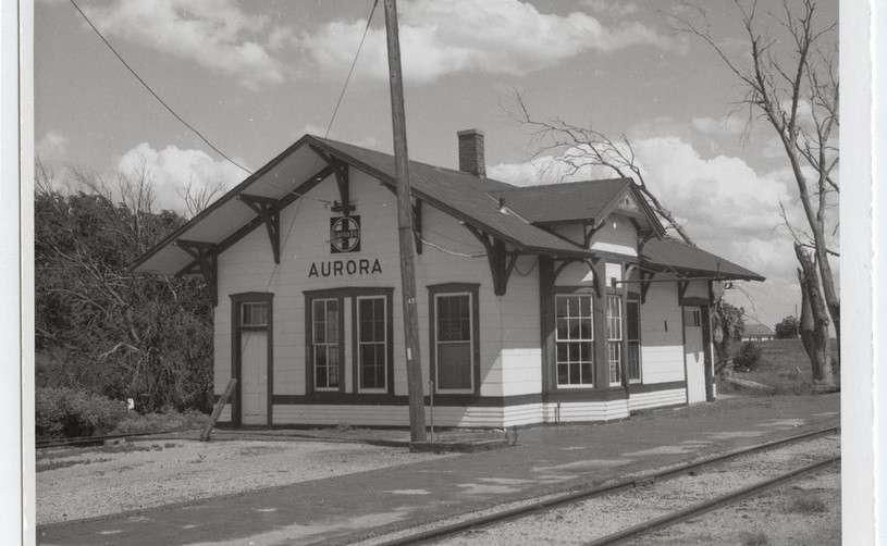 Atchison, Topeka and Santa Fe Railway Company depot, Aurora, Kansas This photograph shows the Atchison, Topeka and Santa Fe Railway Company depot in Auroa, Kansas. The one-story wooden structure built in 1887 still stands and is used for storage. Date: 1970