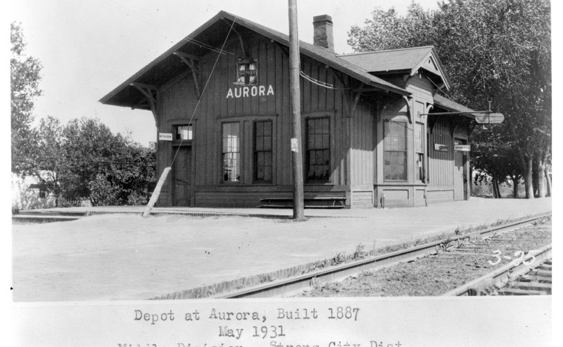 Atchison, Topeka and Santa Fe Railway Company depot, Aurora, Kansas This photograph shows the Atchison, Topeka and Santa Fe Railway Company depot in Aurora, Kansas. The one-story wooden structure was built in 1887 as part of the Middle Division, Strong City District. Date: May 1931