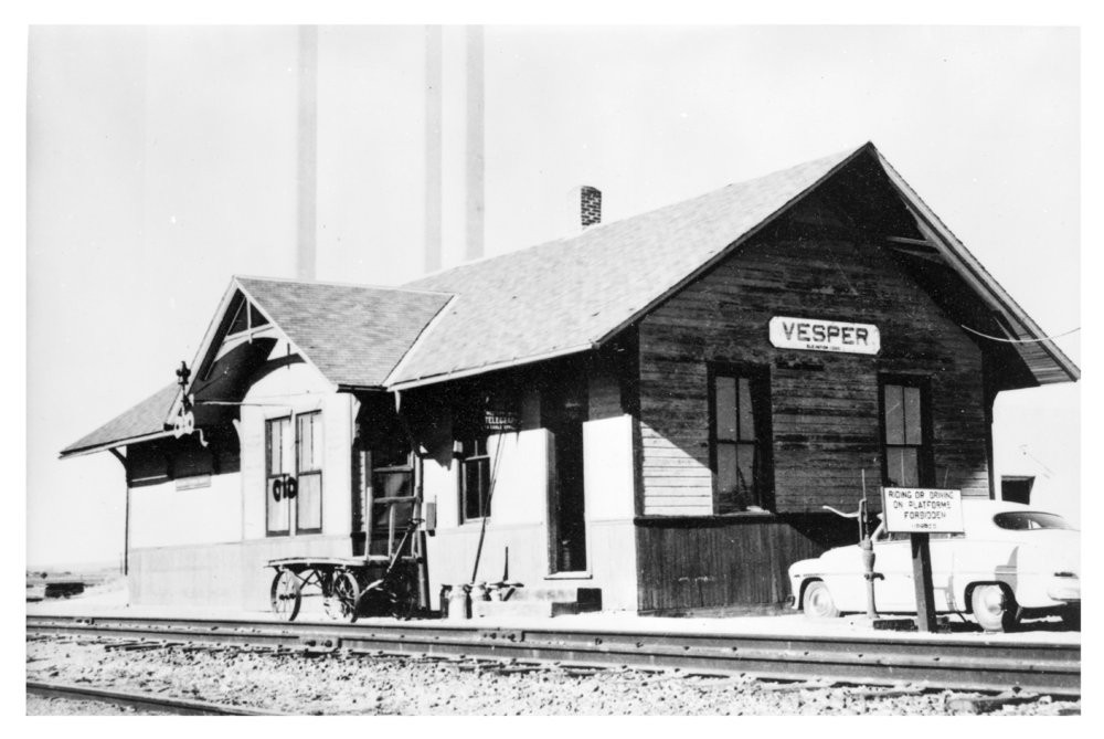 Union Pacific Railroad Company depot, Vesper, Kansas This photograph shows the Union Pacific Railroad Company depot in Vesper, Kansas. The one-story wooden structure no longer stands. Date: Between 1950s and 1960s