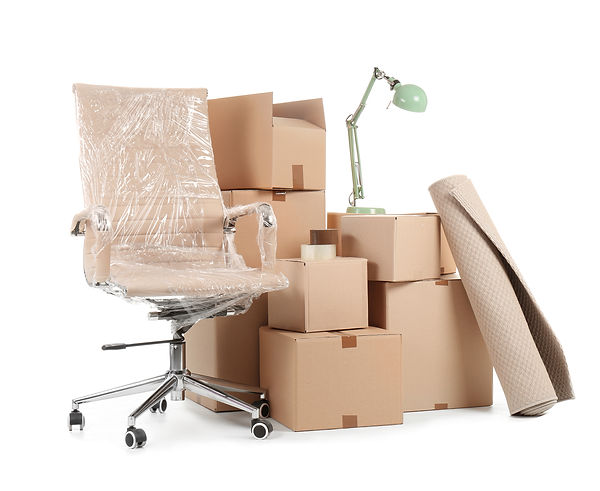 Cardboard boxes and household stuff on w