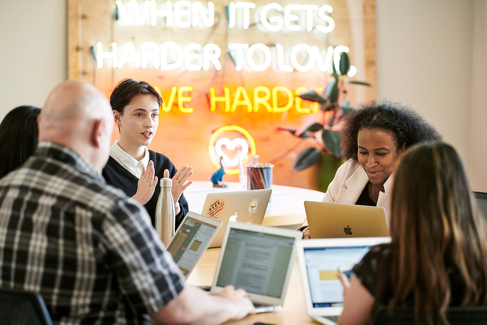 Members of Dream Corps collaborate in the non-profit's Oakland headquarters. Photo from Apple.