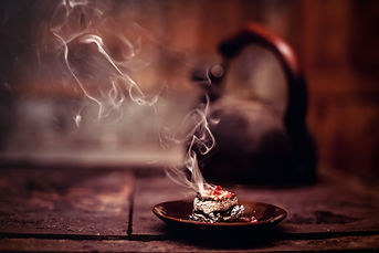 Frankincense burning on a hot coal. Arom