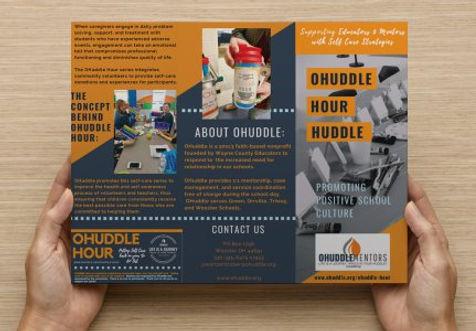 OHuddle Hour Brochure held.jpeg
