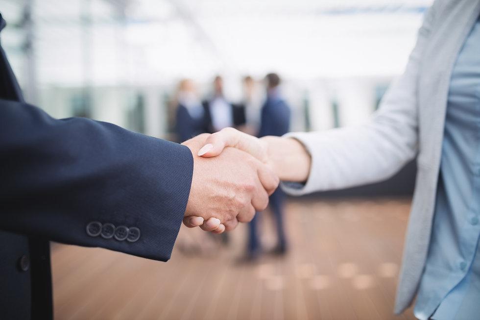 businesspeople-shaking-hands.jpg