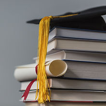 books-with-graduation-cap-and-diploma.jp