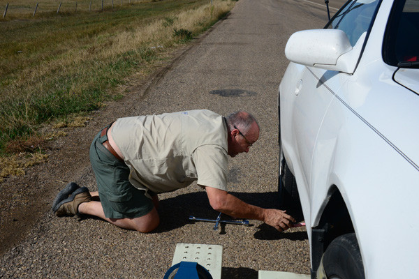 Tony Hill with flat tire on Wyoming and South Dakota boarder