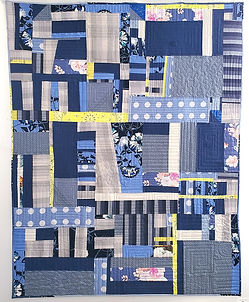 Fayetteville More or Less. Deconstructed garments and other fabrics, machine pieced and quilted. 67 x 57 inches.