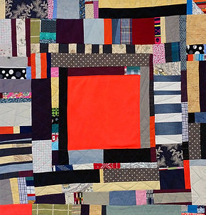 Safety Blankie. Deconstructed garments and other fabrics, machine pieced and quilted with additional hand stitching. 45 x 42 inches.