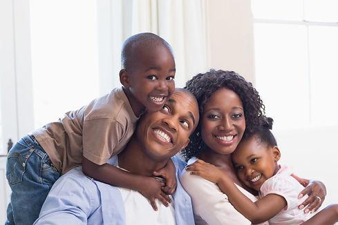 Happy Couple Holding Children