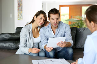 Couple Reviewing Document