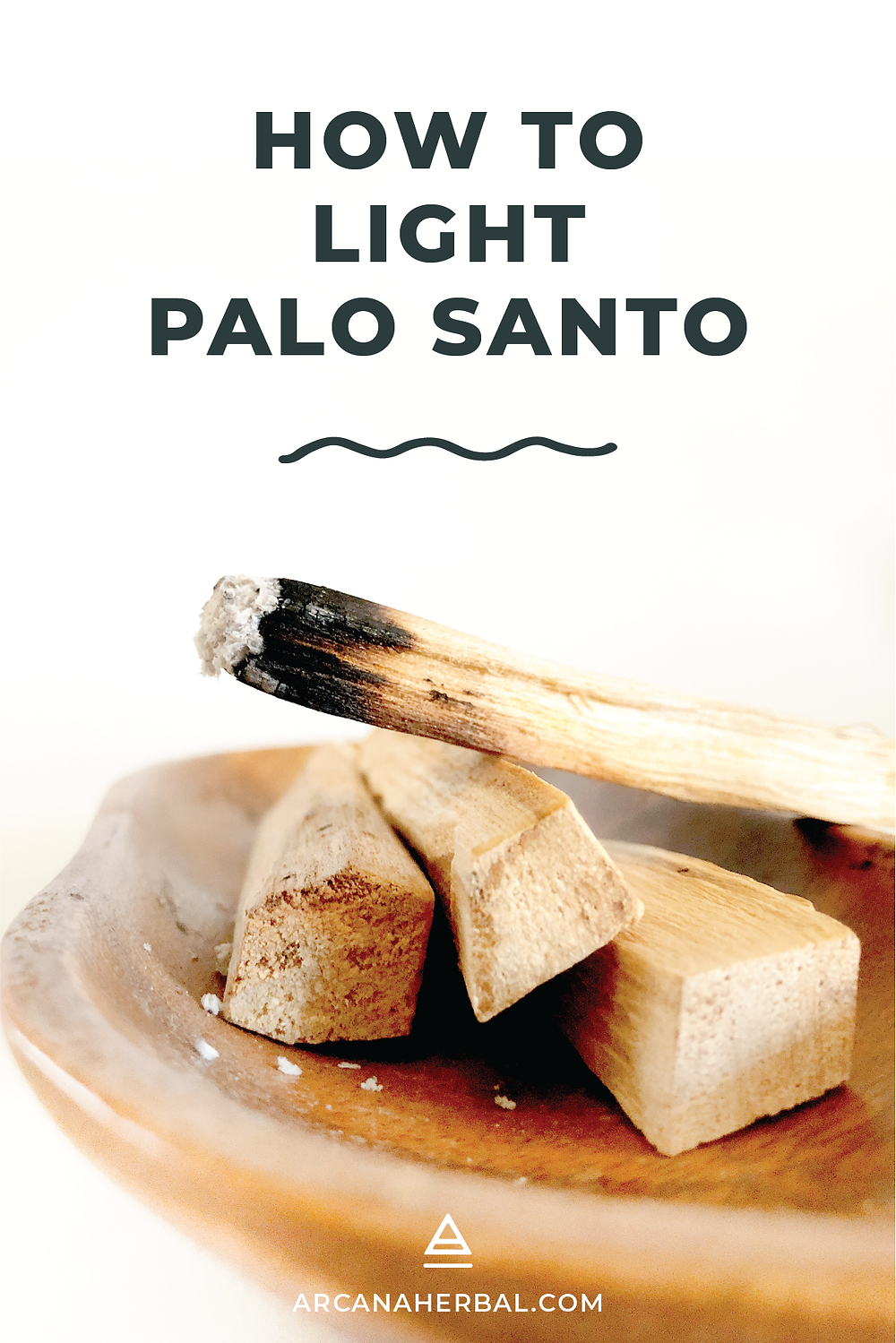 Burning palo santo wood sticks on a wooden tray with a bundle of palo santo sticks.