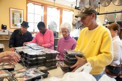 Volunteers Help to Prepare Meal