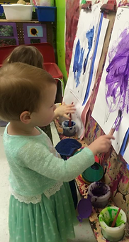 A student paints on an easel