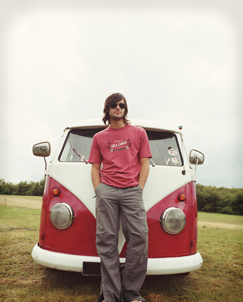 Hipster standing in front of VW bus