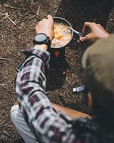 Camper Preparing Meal