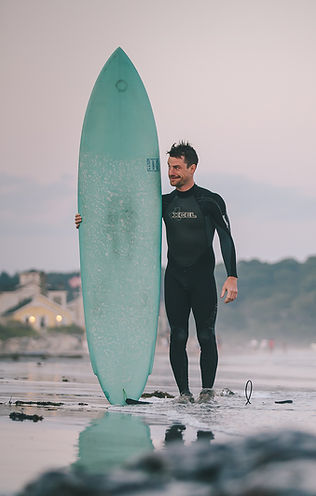 photo of Will Mayo, holding surf board by Randy Williams