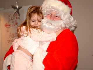 UNDERSERVED KIDS HAVE COOKIES WITH SANTA