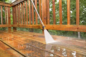 pressure-washer-cleaning-a-weathered-dec