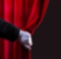 Hand-pulling-back-curtain.jpg
