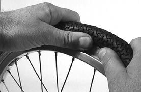 removing pushchair tyre