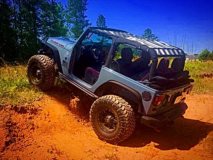 Wrangler JK 2 door sun shade top on the trail
