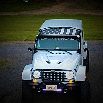Jeep Wrangler black and white US flag sun shade top