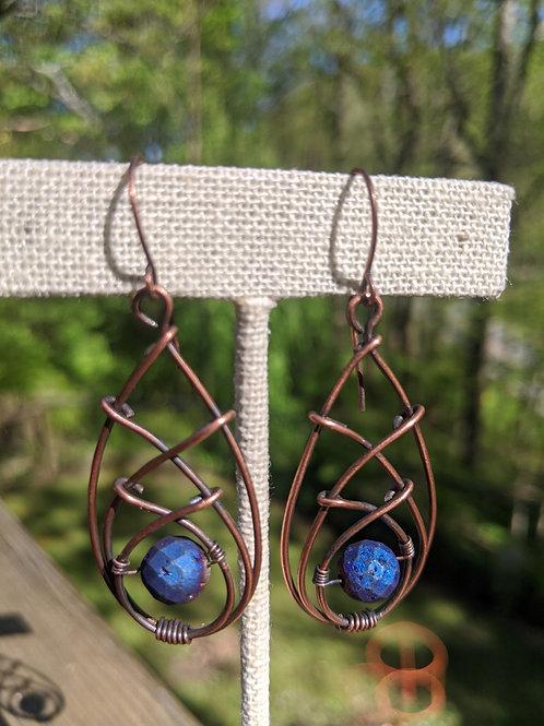 Triple wire crossed teardrop earrings.