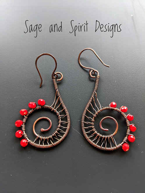 Large copper spiral earrings: red