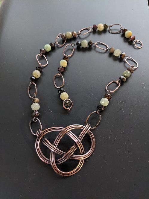 Copper celtic knot: burmese jade and tourmaline
