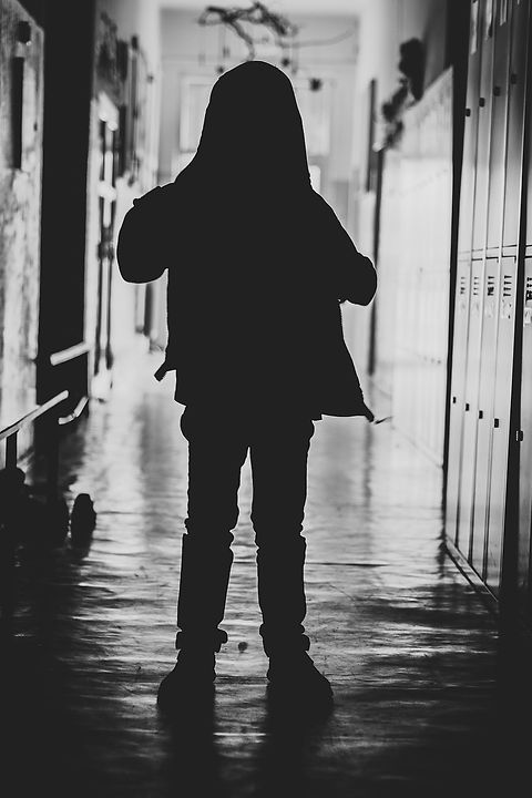 "Hidden boy in school hall: A wounded inner child can actually make us want to ""hide"" from our peers. It impacts our social skills."