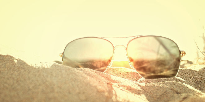 Sunglasses_on_the_Sand_at_Sunset_-_Beach