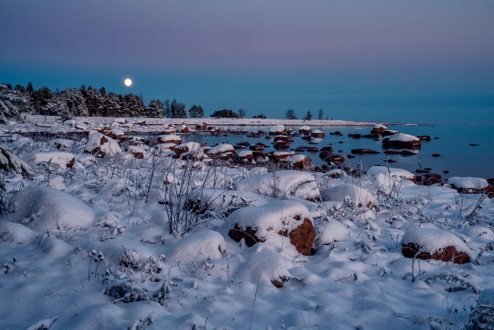 winter by the sea with full moon