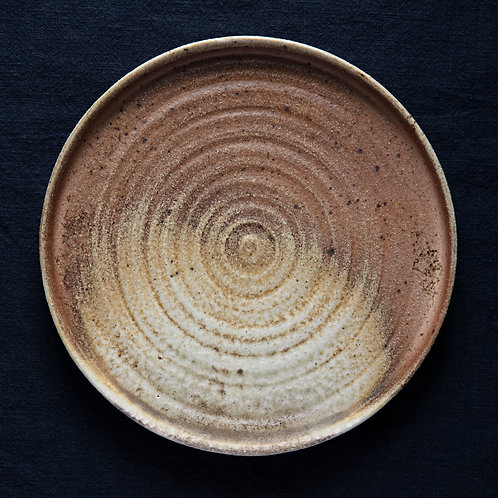 Flat plate with round wheel marks, wood fired