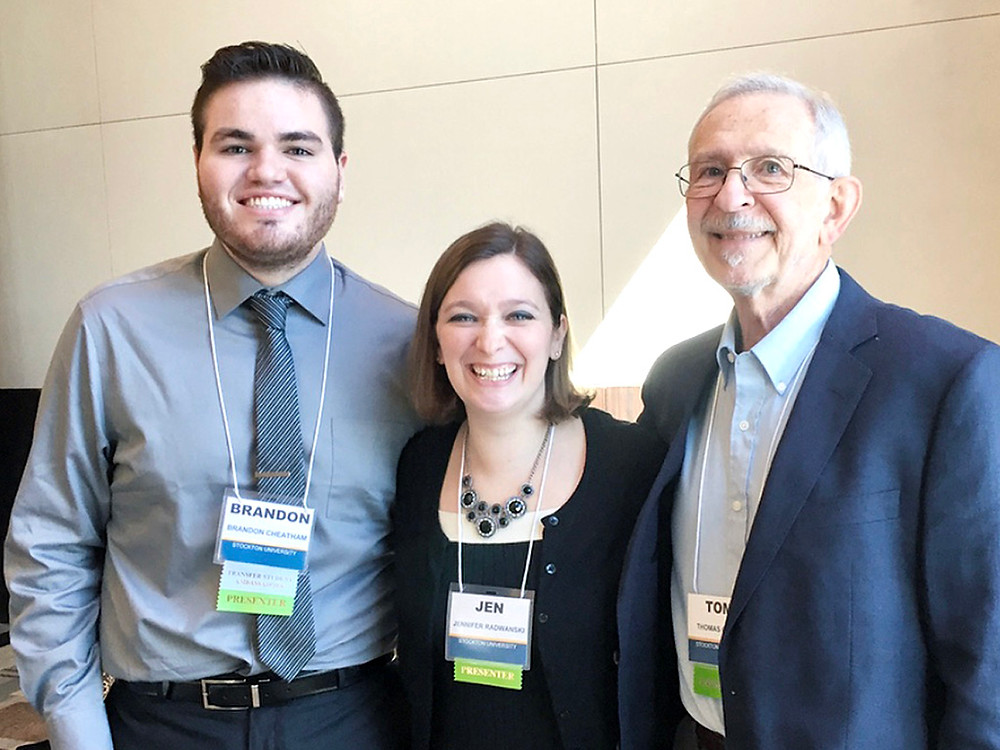 Brandon posing at the NISTS 2018 conference with his concurrent session co-presenters, Jen and Tom