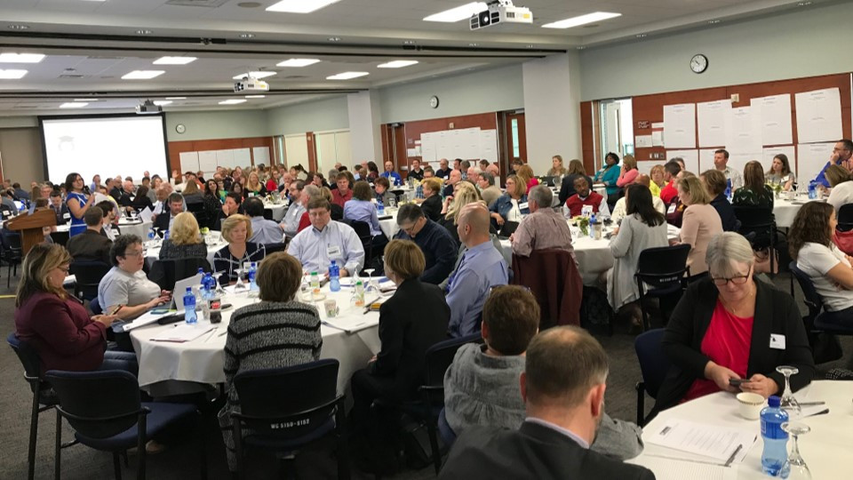 Faculty, staff, and administrators from across Michigan are collaborating with each other at round tables during the first MiTransfer Pathways meeting.