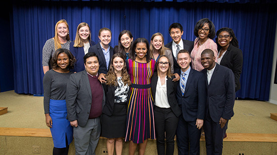 Luis posing with other White House interns and First Lady Michelle Obama