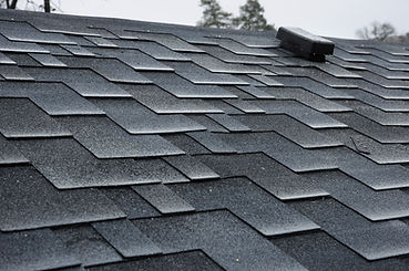 Close up view on asphalt roofing shingle