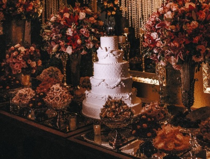 5 layer wedding cake surrounded with assorted-color flower arrangement with lighted chandeliers_edit