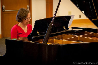 Adult student playing at a recital