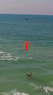 Drone save person at sea