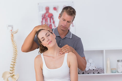 Close up of doctor doing neck adjustment