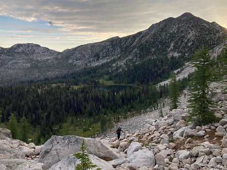 Hiker climbing up pass from Peepsight Lake