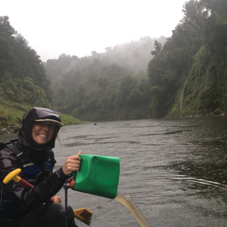 Paddling on the Whanganui River. Caught in a rainstorm.