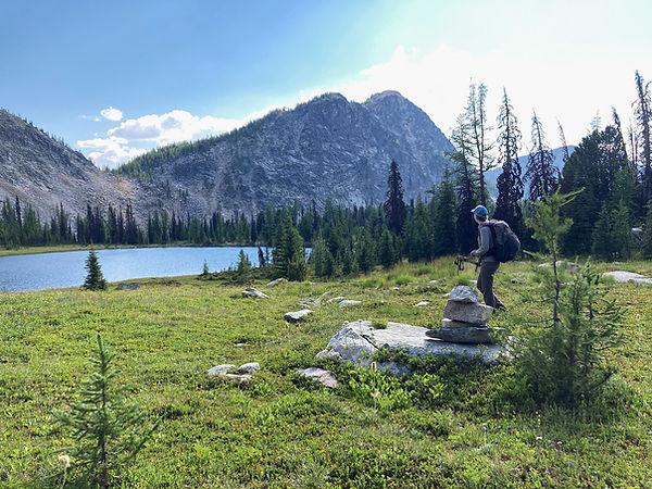 Hiker in Pasayten Wilderness at Peepsight Lake