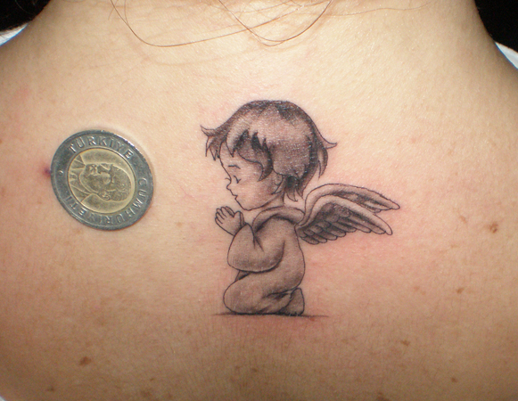 baby_angel_tattoo_2_by_Streetbodyart34.jpg