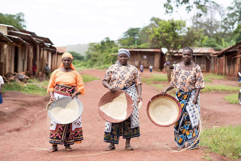 Women artisans holding their bowls